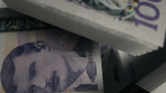 Norwegian kronor notes scattered pile pan above Stock Footage