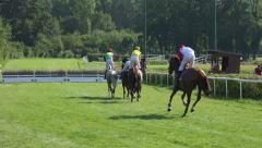 4k Horse Racing show jumpers check the hurdle Stock Footage