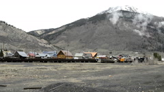 Historic steam train passes rail yard in Silverton-N8-HD P-1920 Stock Footage