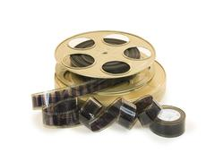 35mm film in reel and its can - stock photo