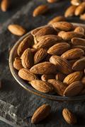 raw organic brown almonds - stock photo
