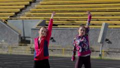 Sport DM 008 Young girls spend training exercises before the race Stock Footage