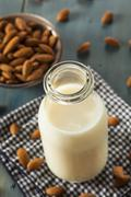 organic white almond milk - stock photo