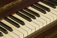 Old piano keyboard tilt view - stock photo