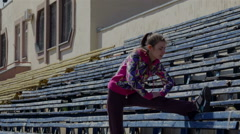 Sport DM 010 Stretching for legs and feet before the race in the stadium Stock Footage