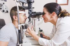 optical lab, professional woman. - stock photo