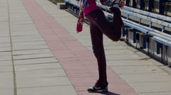 Sport DM 011 Stretching for legs and feet before the race in the stadium Stock Footage