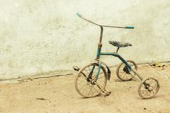 old rickety tricycle - stock photo