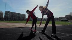 Sport DM 013 Young girls spend training exercises before the race Stock Footage