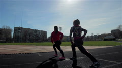 Sport DM 015 Young girls spend training exercises before the race Stock Footage