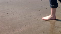 The Girl Draws A Heart On The Sand Stock Footage