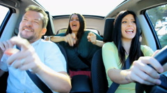 Stock Video Footage of Three happy friends dancing in car