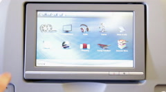 Person browsing screen on the airplane monitor display. - stock footage