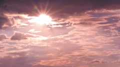 Sun shining through the clouds Stock Footage
