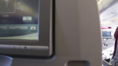 Interior view tracking shot of seat and aisle of an airplane. - stock footage