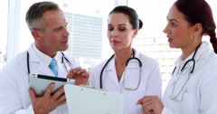 Medical team going over a file together Stock Footage