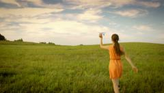 Girl enjoying childhood and freedom, running in the field, dreaming about future Stock Footage