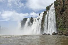 iguassu falls from boat - stock photo