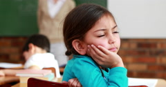 Little girl thinking hard during class - stock footage