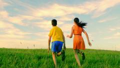 Two friends enjoying childhood in summer, field, freedom, together Stock Footage