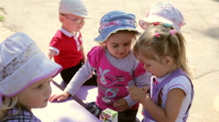Children Playing In The Yard Stock Footage
