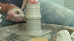 Potter shaping a tall vase f 5 Stock Footage