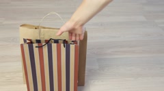 Female hand holding paper bags Stock Footage