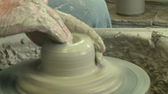 Potter shaping a tall vase s 3 - stock footage