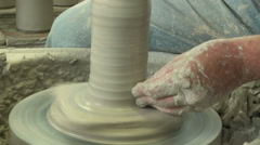 Potter shaping a tall vase s 4b - stock footage