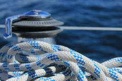 Rope with blurred winch in the background Stock Photos