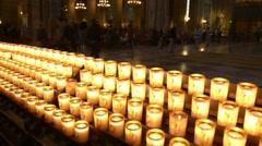 Candles burning in basilica Notre Dame de Paris. Stock Footage