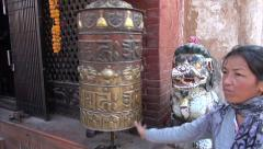 Tibetan buddhist prayers in Katmandu  Boudhanath stupa Stock Footage