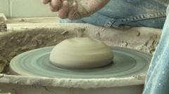 Potter starts a bowl  s 2b Stock Footage