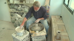 Wide shot potter shaping a tall vase 1 Stock Footage