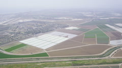 Aerial shot of Agricultural farm land California - stock footage
