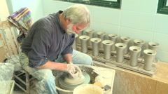Wide shot potter shaping a tall vase 3 Stock Footage