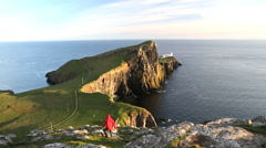 Neist Point male walker Moonen Bay Skye Scotland Stock Footage