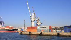 Industrial seaport with containers and a cargo ship berthed in. Stock Footage