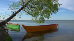 4K  3840x2160 Wooden boat on lake moored to the shore. Stock Footage