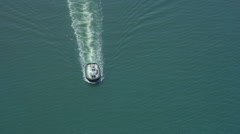 Aerial shot of tug boat at sea - stock footage