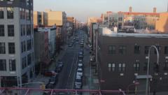 Stock Video Footage of pov Brooklyn apartments at Sunset as filmed from the subway