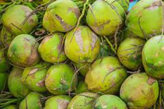 Coconuts heap, food market thailand Stock Photos