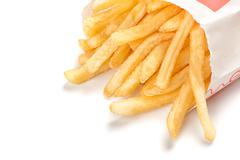Pile of french fries isolated on white Stock Photos