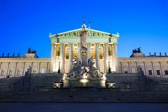 austrian parliament building at night - stock photo
