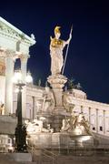 Austrian parliament building at night Stock Photos
