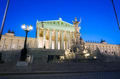 austrian parliament building at night - stock photo