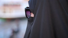Steadycam - Woman with chador, hijab wearing sunglasses Stock Footage
