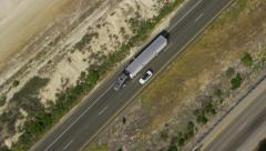 Aerial view of truck following Californian coastline Stock Footage