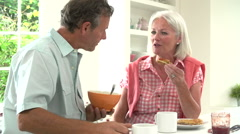 Middle Aged Couple Having Breakfast Together In Kitchen - stock footage