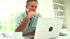 Middle Aged Man Using Laptop And Eating Breakfast Stock Footage